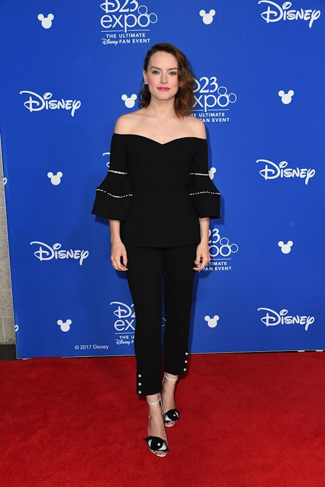 <p>For the live action presentation at Disney's D23 EXPO 2017 in Anaheim, California earlier this year, Daisy sported an off-the-shoulder black top with bell-bottom inspired sleeves. </p>