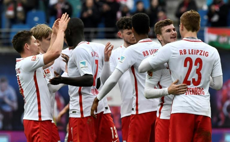 Leipzig players celebrate after their match against SC Freiburg in Leipzig, eastern Germany, on April 15, 2017