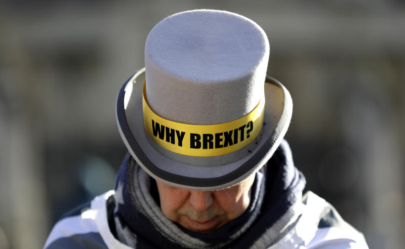 Why Brexit? written on the hat of Anti-Brexit campaigner Steve Bray as he stands outside Parliament in London, Wednesday, Jan. 29, 2020. Britain officially leaves the European Union on Friday after a debilitating political period that has bitterly divided the nation since the 2016 Brexit referendum. (AP Photo/Kirsty Wigglesworth)