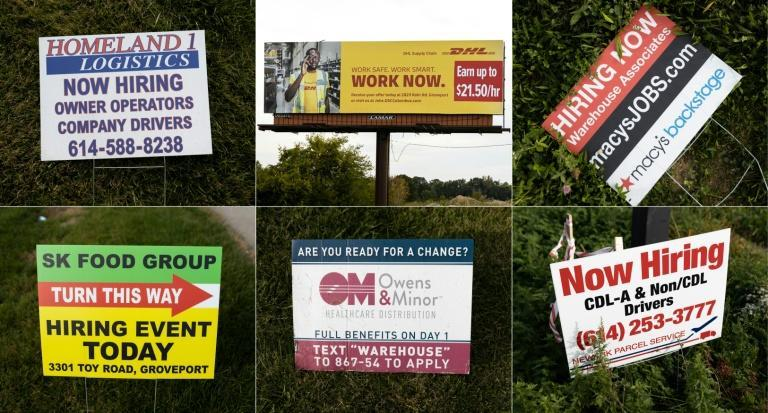 Some of the hiring signs posted around Rickenbacker International Airport in Columbus, Ohio as firms look to recruit scarce workers (AFP/MEGAN JELINGER)