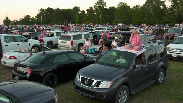 Socially-distancing fans attend the Alan Jackson concert in Cullman, Ala. / Credit: CBS News