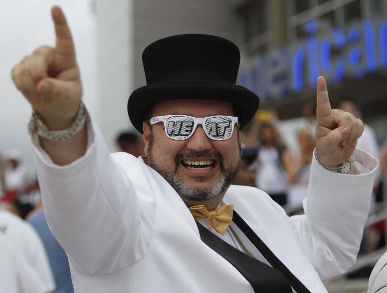 Miami Heat fan George Gonzalez shows his support before Game 5 of the NBA finals basketball series against the Oklahoma City Thunder, Thursday, June 21, 2012, in Miami. (AP Photo/Lynne Sladky)