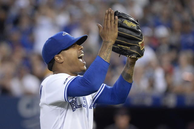 Toronto Blue Jays starting pitcher Marcus Stroman (6) reacts as he walks to the dugout after finishing the top of the seventh inning of a baseball game against the Cleveland Indians, Wednesday, July 24, 2019 in Toronto. (Nathan Denette/Canadian Press via AP)