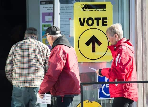 People arrive to cast their ballots at a polling station on federal election day in Shawinigan, Que., Monday, Oct. 21, 2019. (Graham Hughes/The Canadian Press - image credit)