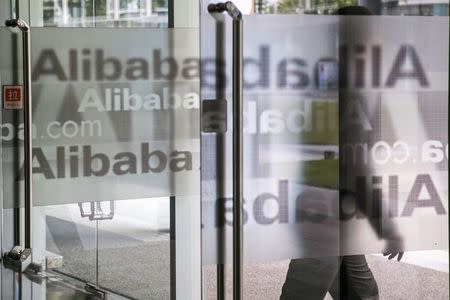 A man walks out of a building at Alibaba's headquarters on the outskirts of Hangzhou