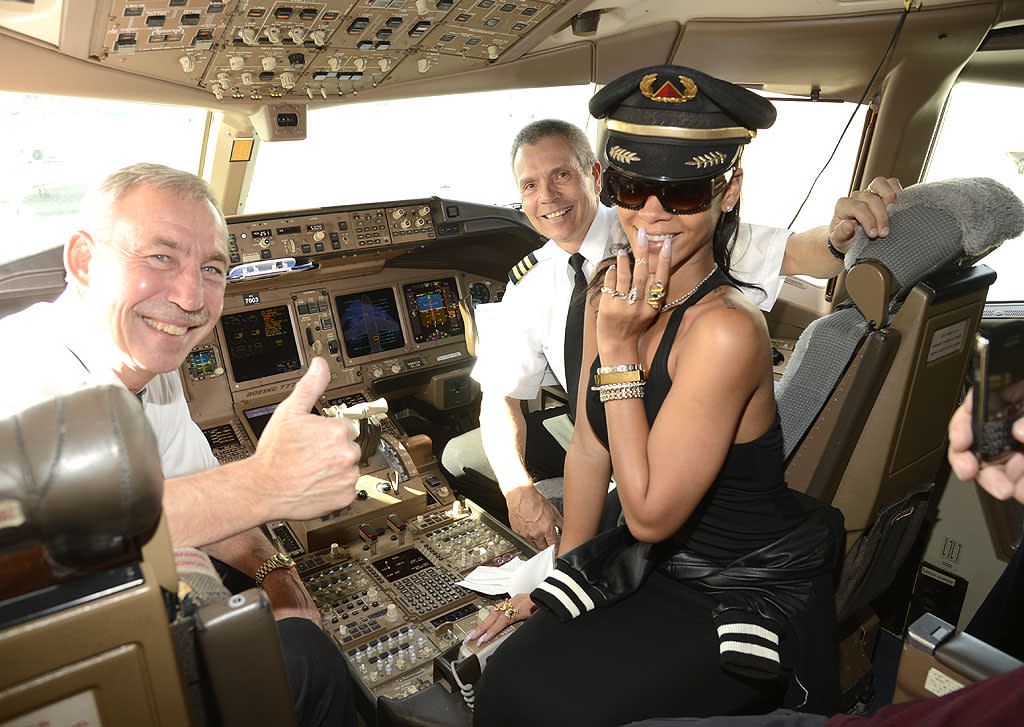 "She's got a lot of talent, but not when it comes to flying a plane, as far as we know. Still, songstress Rihanna tried to look the part when she visited the pilots of a 777 on Wednesday. The pop star is currently touring seven countries in seven days to mark the release of her new album,""Unapologetic."" And she's not traveling alone. Accompanying her on the 300-seat jet are 150 reporters from around the world and even some lucky fans. ""Would everybody look in their gift bag right now?"" she announced over the loud speaker on Wednesday. ""There's a  tiny little string in there, and it looks sh-tty and cheap but if you  read the fine print it's a real diamond. … I don't want you guys to lose  that."" (11/14/2012)"