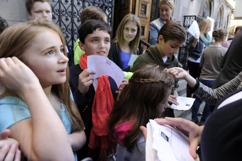 """This Sept. 15, 2013 image released by NBC shows children at an open casting call for the Von Trapp children in NBC's """"The Sound of Music,"""" at Grace Church School in New York. A remake of the 1965 film classic and the original 1959 Broadway production, starring Carrie Underwood and Stephen Moyer, will air on Dec. 5. (AP Photo/NBC, Virginia Sherwood)"""