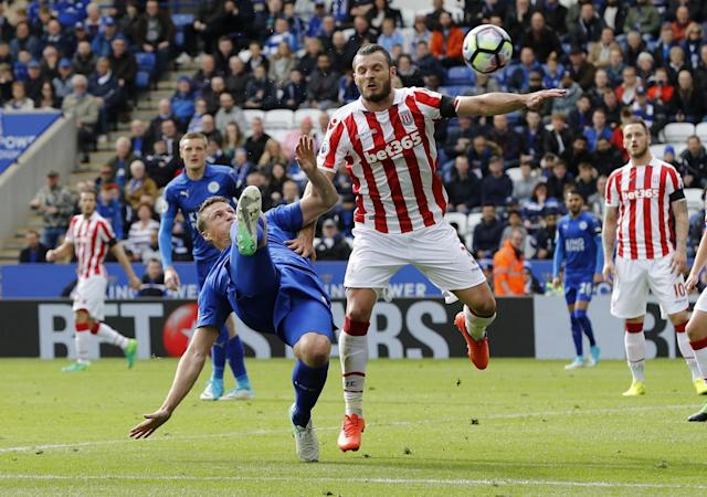 <p>Stoke City's Erik Pieters in action with Leicester City's Robert Huth </p>
