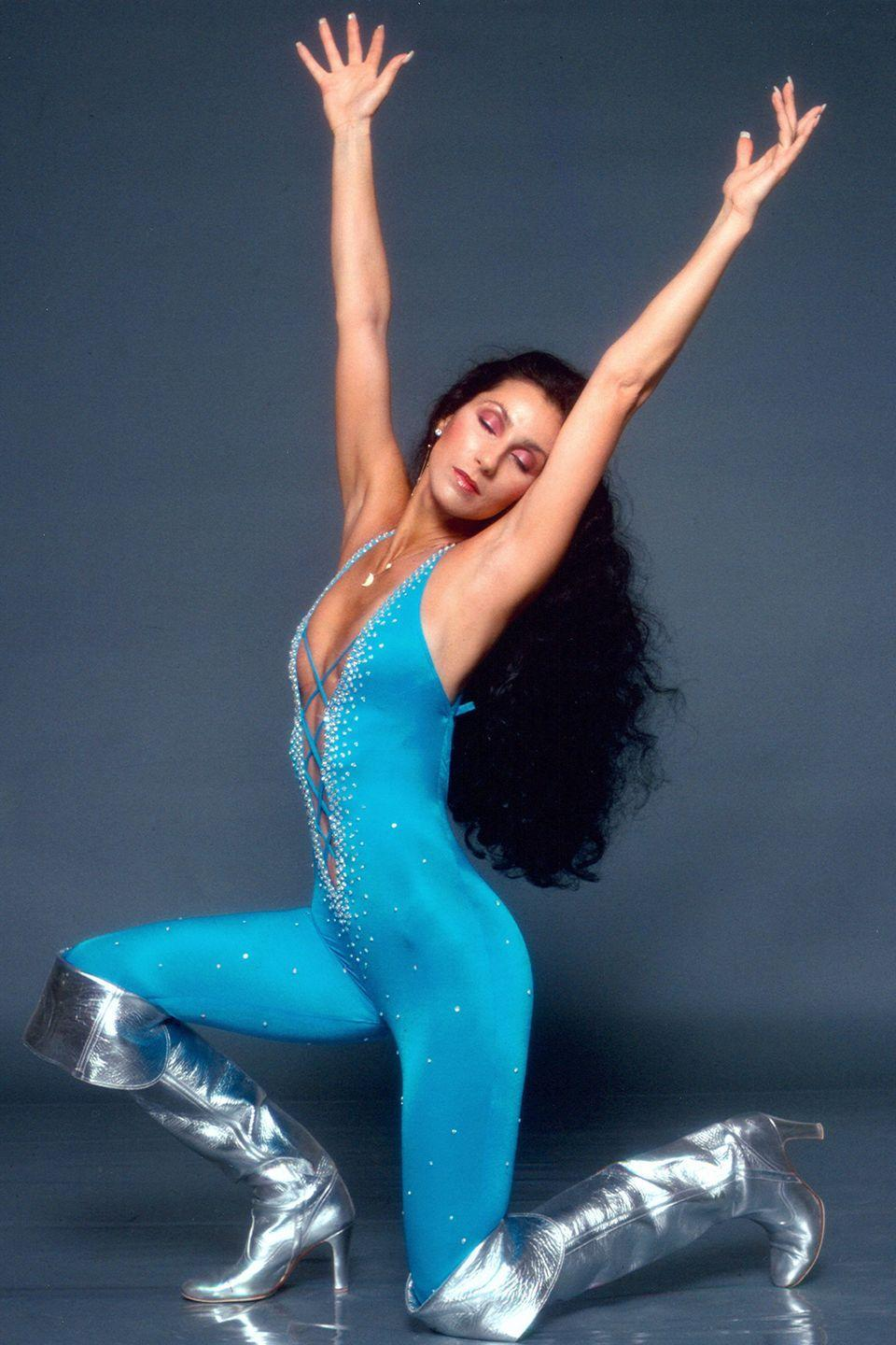 <p>In a leotard and silver knee-high boots for a Bob Mackie portrait session. </p>
