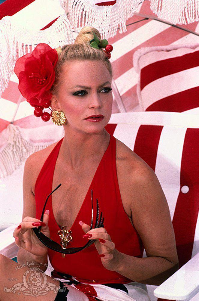 <p>Either suit (belted or scooped) would have looked excellent when paired with excessive gold accessories, as Goldie Hawn's 1987 movie <em>Overboard</em> demonstrates.</p>
