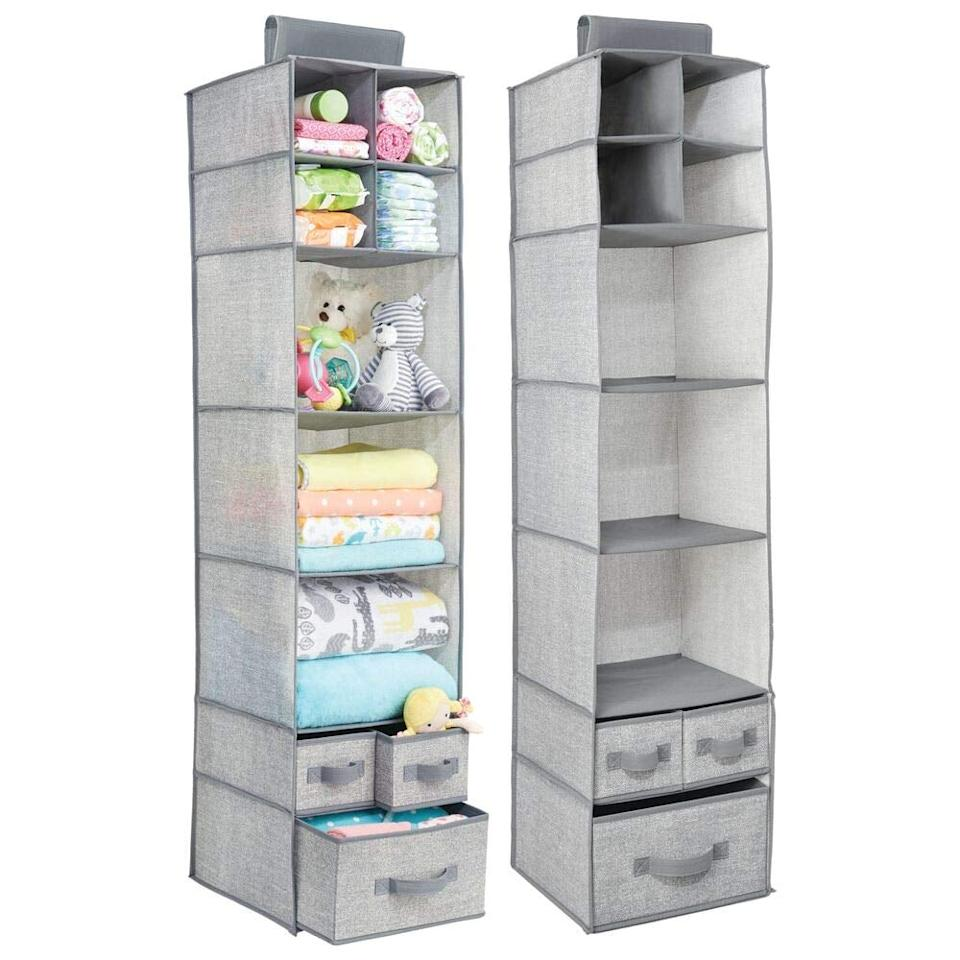 """<p>You can put sweaters, towels, and so much more in this <a href=""""https://www.popsugar.com/buy/mDesign-Fabric-Closet-Hanging-Storage-Organizer-483850?p_name=mDesign%20Fabric%20Closet%20Hanging%20Storage%20Organizer&retailer=amazon.com&pid=483850&price=27&evar1=casa%3Aus&evar9=46534838&evar98=https%3A%2F%2Fwww.popsugar.com%2Fhome%2Fphoto-gallery%2F46534838%2Fimage%2F46535446%2FmDesign-Fabric-Over-Closet-Rod-Hanging-Storage-Organizer&list1=shopping%2Corganizing%2Cfurniture%2Cbedrooms%2Chome%20organization%2Chome%20shopping&prop13=mobile&pdata=1"""" rel=""""nofollow"""" data-shoppable-link=""""1"""" target=""""_blank"""" class=""""ga-track"""" data-ga-category=""""Related"""" data-ga-label=""""https://www.amazon.com/mDesign-Hanging-Storage-Organizer-Removable/dp/B06WVN3YMM/ref=sr_1_62?keywords=bedroom+organizers&amp;qid=1566582289&amp;s=gateway&amp;sr=8-62"""" data-ga-action=""""In-Line Links"""">mDesign Fabric Closet Hanging Storage Organizer</a> ($27).</p>"""