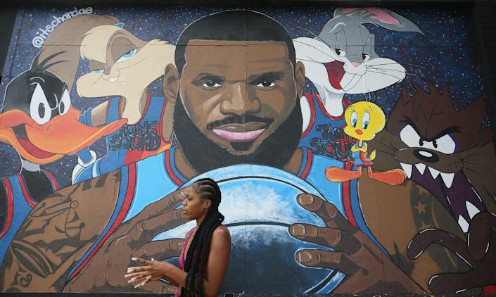 """Chardae Slater, 24, a Kent State University art student, talks about painting the LeBron James """"Space Jam"""" mural on West Market and North Valley Street on Wednesday July 21, 2021."""