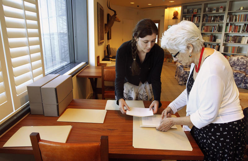 In this Sept. 11, 2012, photo Hemingway curator Susan Wrynn, right, and intern Jessica Green collate documents from the Hemingway collection at the John F. Kennedy Library and Museum in Boston. Among letters written to Ernest Hemingway slated for repair are dispatches from public figures including Hollywood stars Ingrid Bergman and Marlene Dietrich, writers F. Scott Fitzgerald and Gertrude Stein, and Hemingway's editor Max Perkins. (AP Photo/Stephan Savoia)