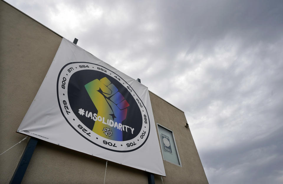 A poster advocating union solidarity hangs from an office building housing The International Alliance of Theatrical Stage Employees (IATSE) Local 705, Monday, Oct. 4, 2021, in Los Angeles. The IATSE overwhelmingly voted to authorize a strike for the first time in its 128-year history. (AP Photo/Chris Pizzello)