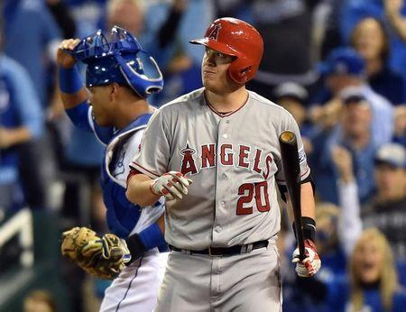 Oct 5, 2014; Kansas City, MO, USA; Los Angeles Angels designated hitter C.J. Cron (20) reacts to striking out against the Kansas City Royals during the fourth inning in game three of the 2014 ALDS baseball playoff game at Kauffman Stadium. Mandatory Credit: Peter G. Aiken-USA TODAY Sports