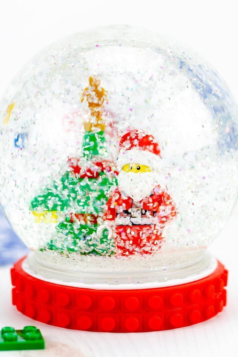 """<p>This is a great kid-friendly snow globe your child will love displaying in his or her bedroom.</p><p><strong>Get the tutorial at <a href=""""https://www.firefliesandmudpies.com/how-to-make-a-snow-globe/"""" rel=""""nofollow noopener"""" target=""""_blank"""" data-ylk=""""slk:Fireflies + Mudpies"""" class=""""link rapid-noclick-resp"""">Fireflies + Mudpies</a>.</strong></p><p><strong><a class=""""link rapid-noclick-resp"""" href=""""https://www.amazon.com/LEGO-Holiday-Mini-Build-Set/dp/B0764BXWTQ/ref=sr_1_13?dchild=1&keywords=christmas+lego+sets&qid=1631742066&sr=8-13&tag=syn-yahoo-20&ascsubtag=%5Bartid%7C10050.g.2832%5Bsrc%7Cyahoo-us"""" rel=""""nofollow noopener"""" target=""""_blank"""" data-ylk=""""slk:SHOP LEGO TOYS"""">SHOP LEGO TOYS</a></strong></p>"""