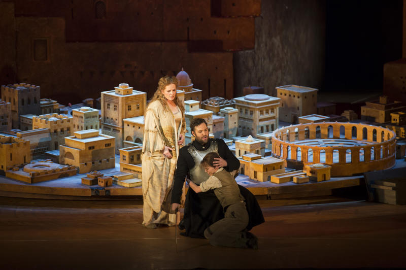 In this image released by the Royal Opera house in London on Monday, June 25, 2012 shows the cast members of the opera Les Troyens, Eva-Maria Westbroek, playing Dido, left, Bryan Hymel playing Aeneas, centre, and Barbara Senator playing Ascanius taken on Wednesday, June 20, 2012. The version by director David McVicar which premiered Monday, June 25 marks the first time the company has performed the full opera in 40 years. It's an official event of the London 2012 Festival being held in conjunction with the Olympics _ and set designer Es Devlin is also designing the closing ceremony for the Games. (AP Photo/Bill Cooper, Royal Opera House)