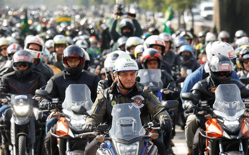 Jair Bolsonaro, front, during a motorcycle tour with his followers in Sao Paulo - Alan Santos/Presidency of Brazil/HANDOUT/EPA-EFE/Shutterstock