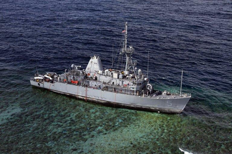 This file photo shows USS Guardian warship, on January 22, 2013, sitting aground on the Tubbataha Reef in the Sulu Sea, Philippines, where it ran aground five days earlier. The Philippines will ask the US to pay $1.4 mln in compensation for damage caused by the ship to a protected coral reef, according to the manager of the reef