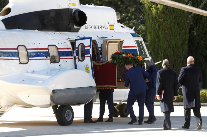 The coffin with the remains of Spanish dictator General Francisco Franco is loaded in a military helicopter at the Fallen mausoleum near El Escorial, outskirts of Madrid, Spain, Thursday, Oct. 24, 2019. Forty-four years after his demise, the remains of Spanish dictator Gen. Spain has exhumed the remains of Spanish dictator Gen. Francisco Franco from his grandiose mausoleum outside Madrid so he can be reburied in a small family crypt north of the capital. (AP Photo/J.J. Guillén, Pool)