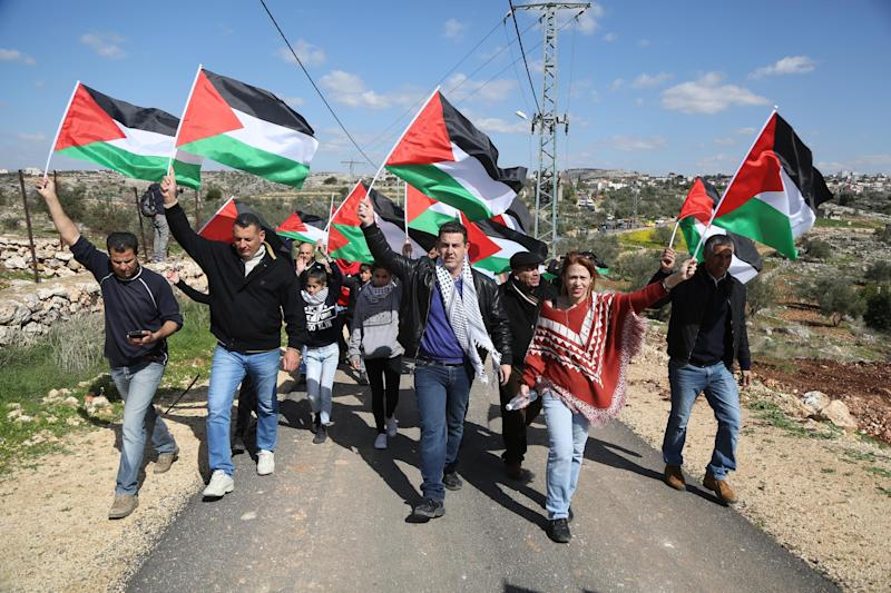 Palestinians stage a protest against Israel's separation wall.   (Issam Rimawi/Getty Images)