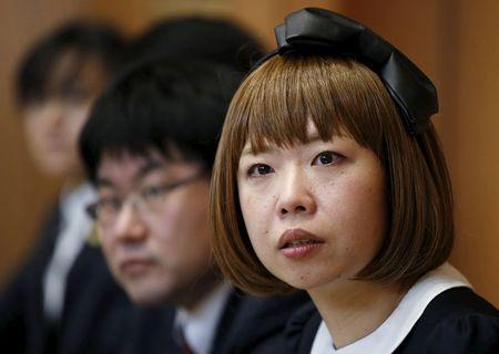 Japanese artist Megumi Igarashi (R), known as Rokudenashiko, attends a news conference with lawyers following a court appearance in Tokyo April 15, 2015. REUTERS/Toru Hanai