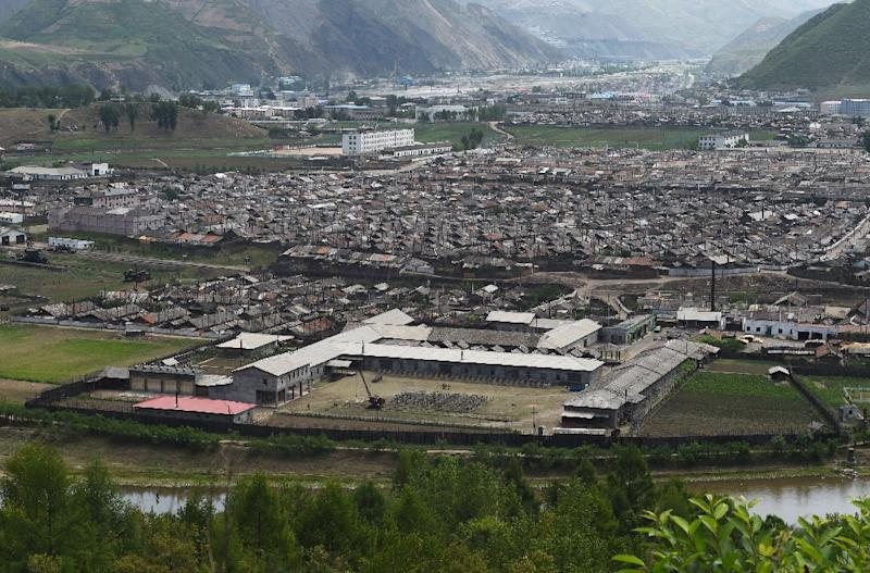 The North Korean town of Musan, seen across the border from China's north-east Jilin province (AFP Photo/Greg Baker)