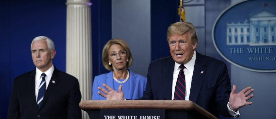 """<span class=""""caption"""">The White House is threatening to cut funds to school districts that don't resume daily in-person instruction.</span> <span class=""""attribution""""><a class=""""link rapid-noclick-resp"""" href=""""https://www.gettyimages.com/detail/news-photo/president-donald-trump-speaks-as-vice-president-secretary-news-photo/1215228995"""" rel=""""nofollow noopener"""" target=""""_blank"""" data-ylk=""""slk:Drew Angerer/Getty Images"""">Drew Angerer/Getty Images</a></span>"""
