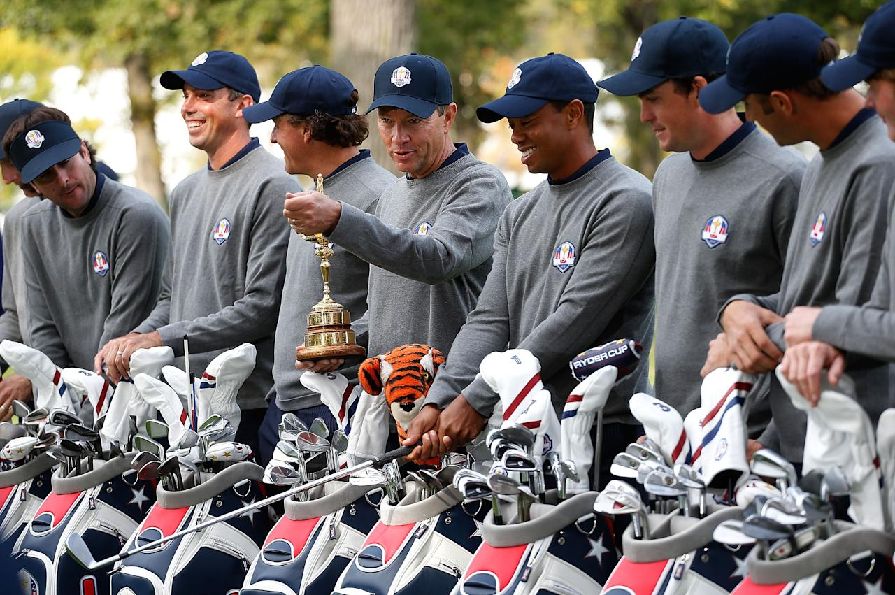 MEDINAH, IL - SEPTEMBER 25:  USA Team captain Davis Love III (C) chats with Tiger Woods during an official photograph with his team and the Ryder Cup during the second preview day of The 39th Ryder Cup at Medinah Country Golf Club on September 25, 2012 in Medinah, Illinois.  (Photo by Jamie Squire/Getty Images)
