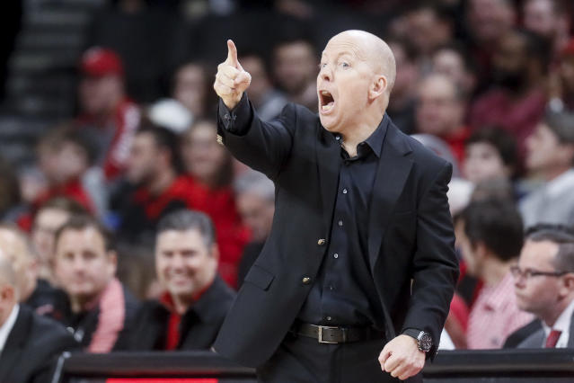 Cincinnati head coach Mick Cronin directs his players from the bench in the first half of an NCAA college basketball game against Connecticut, Saturday, Jan. 12, 2019, in Cincinnati. (AP Photo/John Minchillo)
