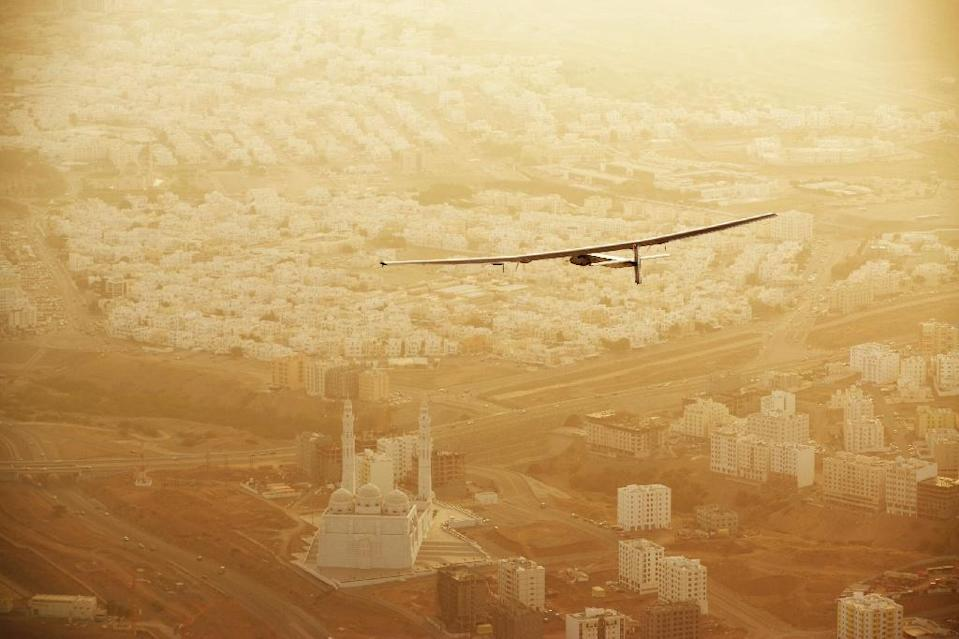 A handout picture released by the Solar Impulse project shows the solar-powered plane Solar Impulse 2 flying over the Omani capital Muscat after taking off on March 10, 2015 (AFP Photo/Jean Revillard)
