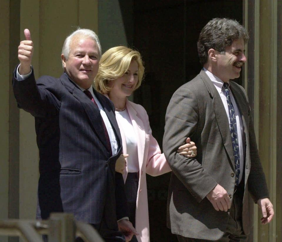 FILE - In this April 19, 2000, file photo, former Louisiana Gov. Edwin Edwards, left, joined by his wife Candy and his defense attorney Daniel Small, gives the thumbs up sign as they leave the federal courthouse in Baton Rouge, La. Edwin Washington Edwards, the high-living four-term governor whose three-decade dominance of Louisiana politics was all but overshadowed by scandal and an eight-year federal prison stretch, died Monday, July 12, 2021 . He was 93. Edwards died of respiratory problems with family and friends by his bedside, family spokesman Leo Honeycutt said. He had suffered bouts of ill health in recent years and entered hospice care this month at his home in Gonzales, near the Louisiana capital. (AP Photo/Bill Haber, File)