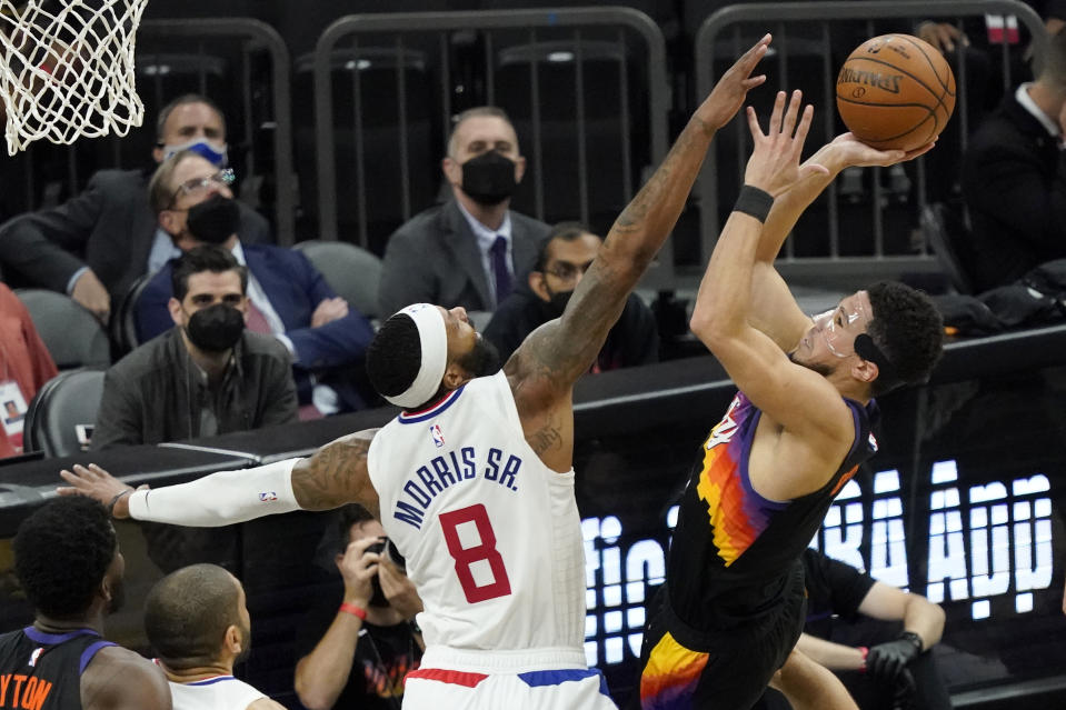 Phoenix Suns guard Devin Booker (1) shoots over Los Angeles Clippers forward Marcus Morris Sr. (8) during the second half of game 5 of the NBA basketball Western Conference Finals, Monday, June 28, 2021, in Phoenix. (AP Photo/Matt York)