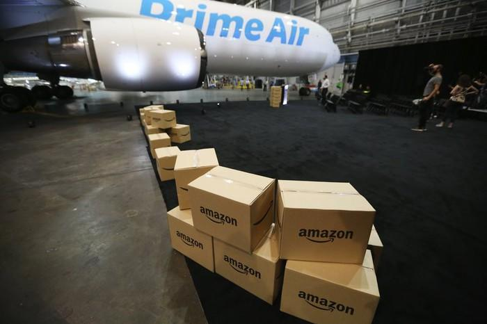 Boxes lined up in front of a Prime Air cargo plane.