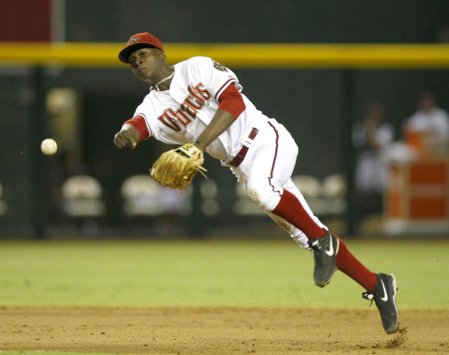 Arizona Diamondbacks shortstop Didi Gregorius (1) makes the off balance throw in the ninth inning during a baseball game against the Baltimore Orioles on Tuesday, Aug. 13, 2013, in Phoenix. (AP Photo/Rick Scuteri)