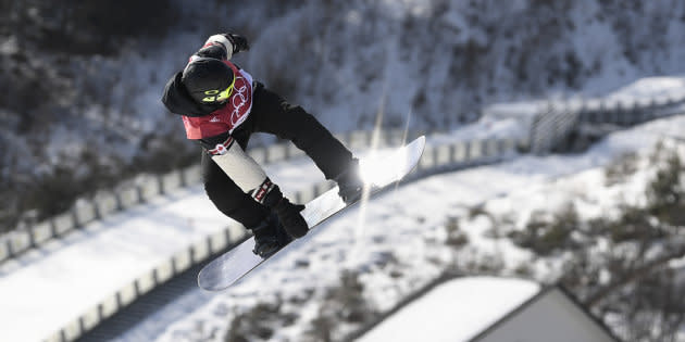 Canada's Sebastien Toutant competes during the qualification of the men's snowboard big air event.