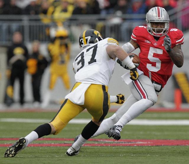 Ohio State quarterback Braxton Miller, right, tries to run past Iowa defensive back John Lowdermilk during the third quarter of an NCAA college football game Saturday, Oct. 19, 2013, in Columbus, Ohio. Ohio State beat Iowa 34-24. (AP Photo/Jay LaPrete)
