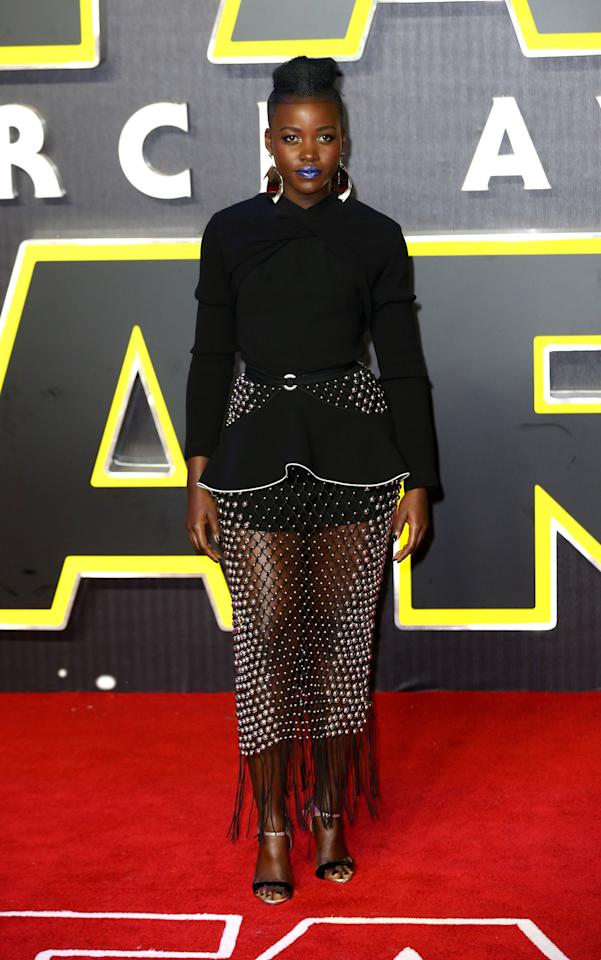 <p>The most fun thing about Lupita Nyong'o starring in a major blockbuster—the blockbuster—is seeing her fashion-forward looks on such a public stage. For Tuesday night's London premiere of <i>Star Wars: The Force Awakens</i>, the actress chose a spring 2016 look from Proenza Schouler, and accessorized with an awesome blue lip.</p><p><i>Photo: Getty Images</i></p>