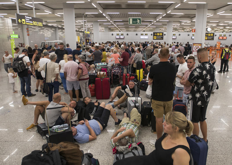 Passengers of British travel group Thomas Cook queue at Son Sant Joan airport in Palma de Mallorca on September 23, 2019. Photo: JAIME REINA/AFP/Getty Images