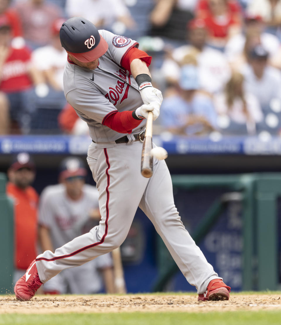 Washington Nationals' Yan Gomes hits a two-run home run during the seventh inning of a baseball game against the Philadelphia Phillies, Thursday, July 29, 2021, in Philadelphia in the first game of a double header. (AP Photo/Laurence Kesterson)