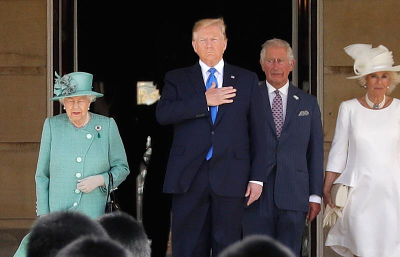 Britain's Queen Elizabeth II stands with President Donald Trump, center, Britain's Prince Charles and Camilla, Duchess of Cornwall, right, during a ceremonial welcome in the garden of Buckingham Palace in London, Monday, June 3, 2019 on the opening day of a three day state visit to Britain. (Photo: Frank Augstein/AP)