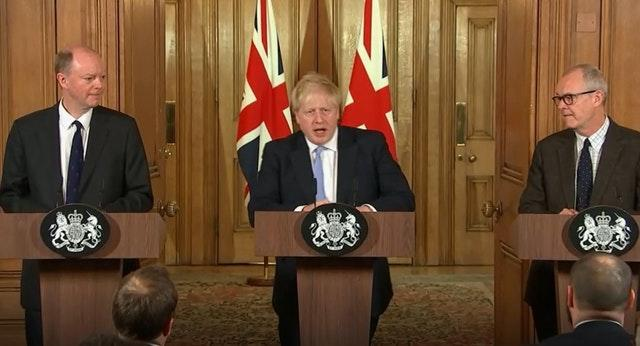 Boris Johnson with England's chief medical officer Chris Whitty, left, and chief scientific adviser Sir Patrick Vallance, right