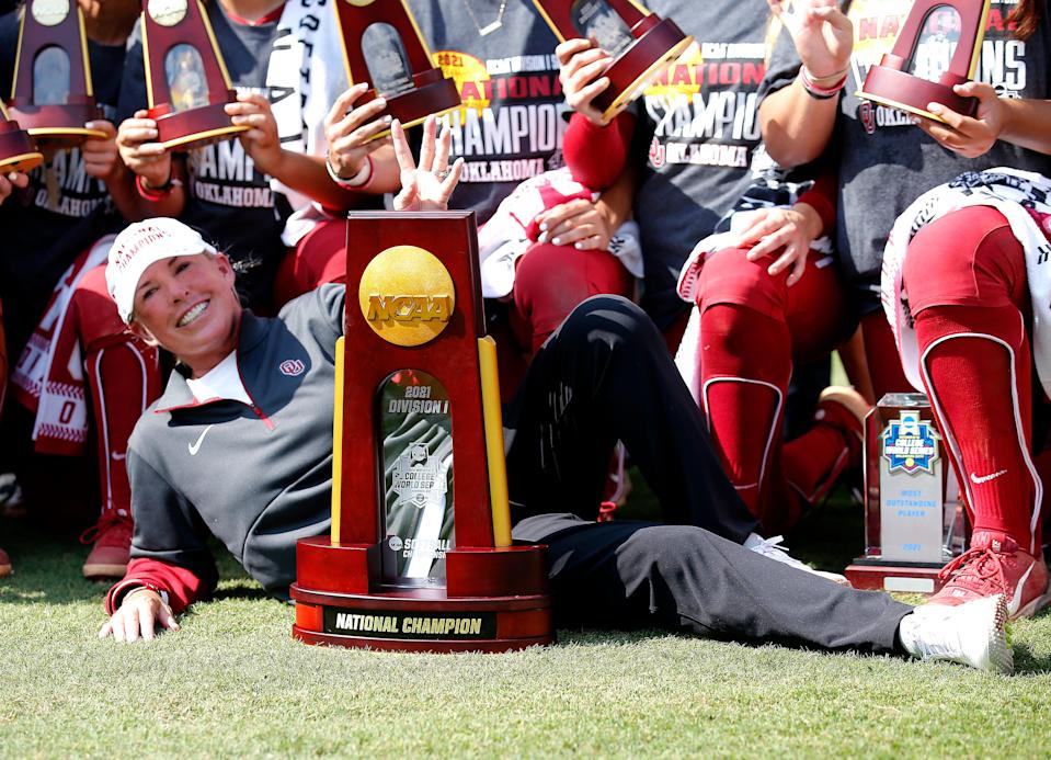 OU head coach Patty Gasso poses with the championship trophy Thursday after guiding the Sooners to their fifth NCAA softball title, joining the 2000, 2013 and 2016-17 teams.