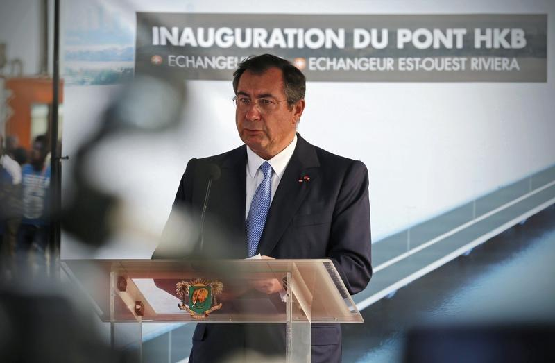 Martin Bouygues, CEO of Bouygues, speaks at the inauguration ceremony for the Henri Konan Bedie toll bridge in Abidjan