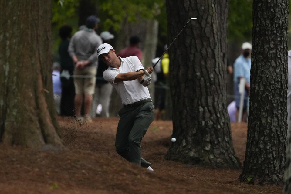 Justin Thomas hits out of the rough on the 13th hole during the third round of the Masters golf tournament on Saturday, April 10, 2021, in Augusta, Ga. (AP Photo/Charlie Riedel)