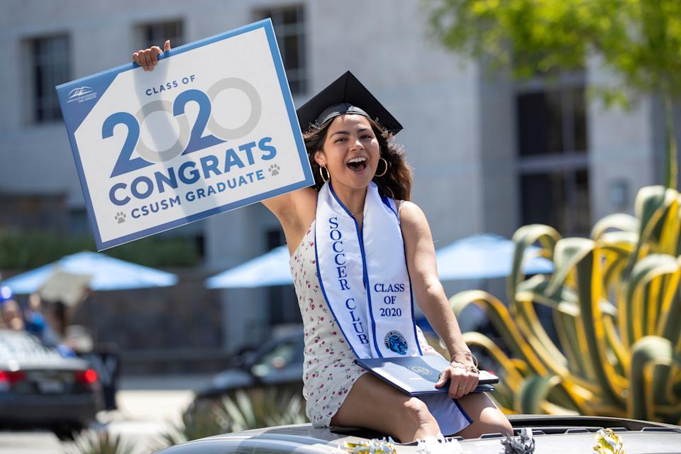 A graduate from California State University San Marcos celebrates while participating in a car parade through campus during the outbreak of the coronavirus disease (COVID-19) in San Marcos, California, U.S., May 15, 2020.      REUTERS/Mike Blake     TPX IMAGES OF THE DAY