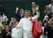 Switzerland's Roger Federer leaves the court after Adrian Mannarino of France retired from the men's singles first round match on day two of the Wimbledon Tennis Championships in London, Tuesday June 29, 2021. (AP Photo/Kirsty Wigglesworth)