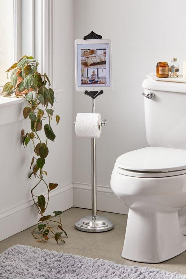 """<p>This <a href=""""https://www.popsugar.com/buy/Toilet-Paper-Holder-Tablet-Stand-501270?p_name=Toilet%20Paper%20Holder%20Tablet%20Stand&retailer=urbanoutfitters.com&pid=501270&price=69&evar1=geek%3Aus&evar9=45632777&evar98=https%3A%2F%2Fwww.popsugar.com%2Fnews%2Fphoto-gallery%2F45632777%2Fimage%2F46760473%2FToilet-Paper-Holder-Tablet-Stand&list1=tech%2Ctech%20shopping%2Ctech%20gifts%2Cbest%20of%202019&prop13=api&pdata=1"""" rel=""""nofollow"""" data-shoppable-link=""""1"""" target=""""_blank"""" class=""""ga-track"""" data-ga-category=""""Related"""" data-ga-label=""""https://www.urbanoutfitters.com/shop/toilet-paper-holder-tablet-stand?category=gadgets-accessories&amp;color=007&amp;type=REGULAR"""" data-ga-action=""""In-Line Links"""">Toilet Paper Holder Tablet Stand</a> ($69) is not only a great gag gift, it might actually come in handy!</p>"""