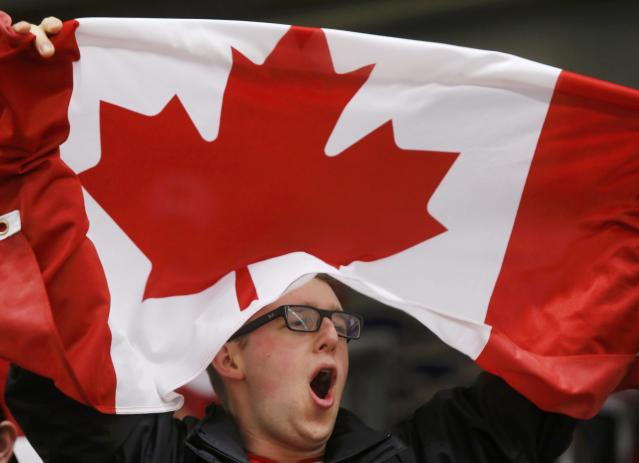 A Canadian supporter cheers before Canada plays the United States in their IIHF World Junior Championship ice hockey game in Malmo, Sweden, December 31, 2013. REUTERS/Alexander Demianchuk (SWEDEN - Tags: SPORT ICE HOCKEY)