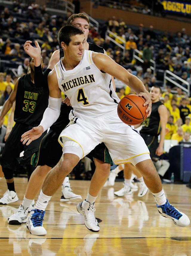 ANN ARBOR, MI - NOVEMBER 01: Mitch McGary #4 of the Michigan Wolverines tries to make a post move in front of Matt Iverson #41 of the Northern Michigan Wildcats during a exhibition game at Crisler Center on November 1, 2012 in Ann Arbor, Michigan. (Photo by Gregory Shamus/Getty Images)